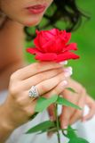 Woman holding single red rose Royalty Free Stock Images