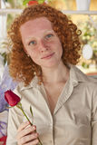 Woman holding a single rose Stock Image