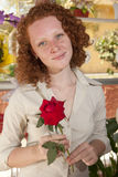 Woman holding a single rose Royalty Free Stock Images
