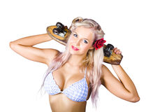 Woman holding skateboard Royalty Free Stock Image
