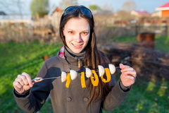 Woman holding skewers of fresh vegetables Stock Images