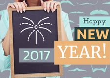 Woman holding slate with a message of happy new year Royalty Free Stock Image