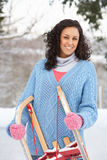 Woman Holding Sledge In Snow Royalty Free Stock Photography