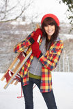 Woman Holding Sledge In Snow Stock Photo