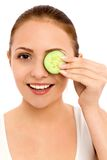Woman holding slice of cucumber stock photos