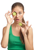 Woman holding slice of cucumber Royalty Free Stock Images