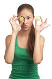 Woman holding slice of cucumber Royalty Free Stock Image