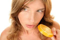 Woman holding slice of orange Royalty Free Stock Photography