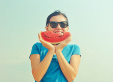 Woman holding a slice of watermelon Royalty Free Stock Images