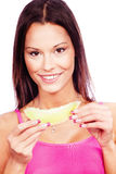 Woman holding slice of yellow melon Stock Images