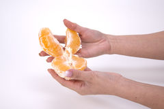 Woman holding slices of orange Royalty Free Stock Image