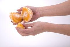 Woman holding slices of orange Stock Photos