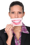 Woman holding sliming card Stock Photo