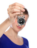 Woman holding a small alarm clock Stock Photos
