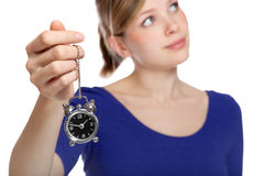 Woman holding a small alarm clock in her hand Stock Photography