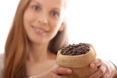 Woman holding a small bag of coffee beans Stock Photography