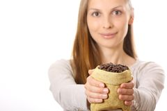 Woman holding a small bag of coffee beans Stock Photos