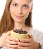 Woman holding a small bag of coffee beans Royalty Free Stock Images