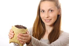Woman holding a small bag of coffee beans Stock Images