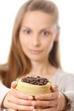 Woman holding a small bag of coffee beans Stock Image