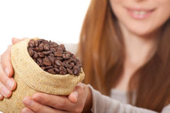 Woman holding a small bag of coffee beans Royalty Free Stock Photography