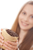Woman holding a small bag of coffee beans Stock Photo
