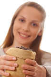 Woman holding a small bag of coffee beans Royalty Free Stock Photos