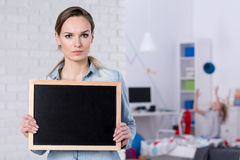 Woman holding small blackboard Royalty Free Stock Photos