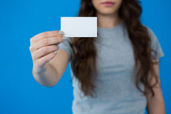 Woman holding a small blank placard Royalty Free Stock Photography