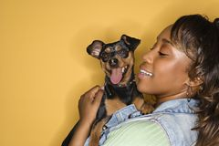 Woman holding small dog. Royalty Free Stock Photography