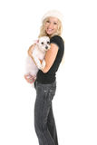 Woman holding a small dog. Smiling woman holding a small clipped white dog Stock Image