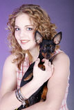 Woman holding a small dog Stock Photography
