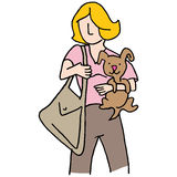 Woman holding small dog Stock Photography