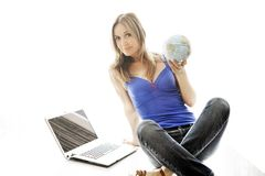 Woman holding a small globe in her hand. Royalty Free Stock Photography