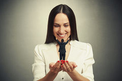 Woman holding small man on the palm Stock Photos