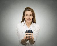 Woman holding small model of house Royalty Free Stock Photo