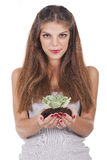 Woman holding a small plant Royalty Free Stock Image