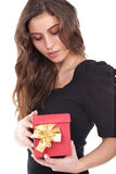 Woman holding a small red gift box Royalty Free Stock Images