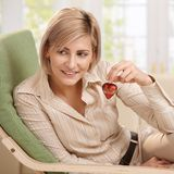 Woman holding small red heart Royalty Free Stock Image