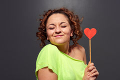 Woman holding small red heart Royalty Free Stock Photo