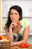 Woman holding small tomato Royalty Free Stock Photo