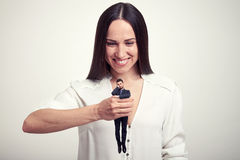Woman holding small wearied man Royalty Free Stock Image