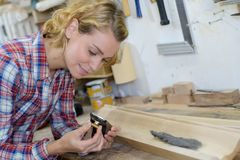 Woman holding wood plane in workshop Royalty Free Stock Photo