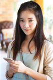 Woman holding smart phone Royalty Free Stock Image