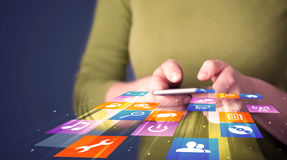 Woman holding smart phone with colorful application icons Stock Photography