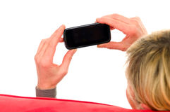 Woman holding a smartphone Stock Image