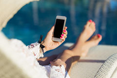 Woman holding smartphone in hand Stock Photo