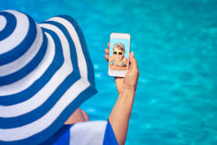 Woman holding smartphone in hand Stock Images
