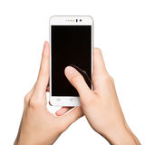 Woman holding smartphone in her hands. Finger touching display. Woman holding smartphone in her hands. Finger touching black display. Isolated on white stock image