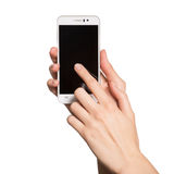 Woman holding smartphone in her hands. Finger touching display. Woman holding smartphone in her hands. Finger touching black display. Isolated on white royalty free stock photography